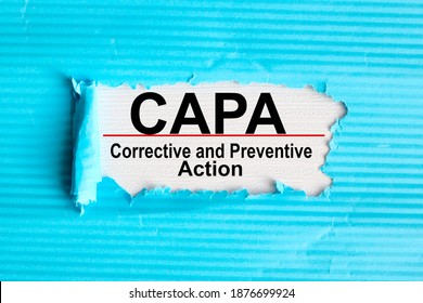 Concept image of Business Acronym CAPA Corrective and Preventive action, text on white paper on notepad on white background