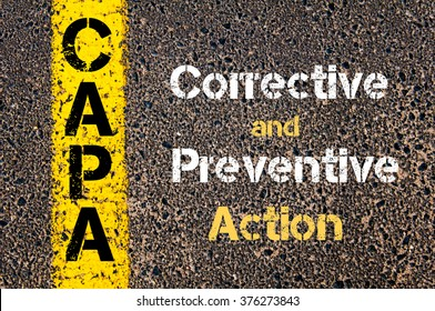 Concept image of Business Acronym CAPA Corrective and Preventive action written over road marking yellow paint line