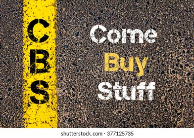 Concept image of Business Acronym CBS Come Buy Stuff written over road marking yellow paint line