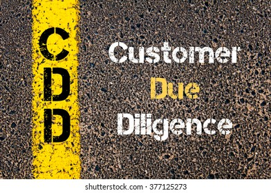 Concept image of Business Acronym CDD Customer Due Diligence written over road marking yellow paint line