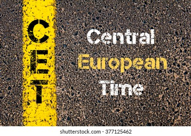Concept image of Business Acronym CET Central European Time written over road marking yellow paint line