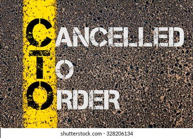 Concept image of Business Acronym CTO as CANCELLED TO ORDER written over road marking yellow paint line.