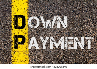 Concept image of Business Acronym DP as DOWN PAYMENT written over road marking yellow paint line.