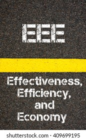 Concept image of Business Acronym EEE Effectiveness, Efficiency, and Economy written over road marking yellow paint line
