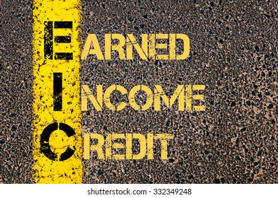 Concept image of Business Acronym EIC as EARNED INCOME CREDIT written over road marking yellow paint line.