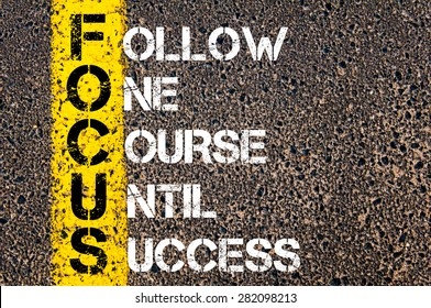 Concept image of Business Acronym FOCUS as FOLLOW ONE COURSE UNTIL SUCCESS  written over road marking yellow paint line.