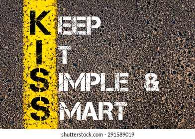 Concept image of Business Acronym KISS as Keep It Simple and Smart written over road marking yellow paint line.