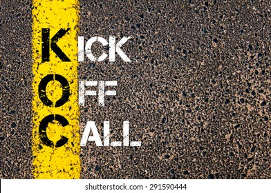 Concept image of Business Acronym KOC as KickOff Call written over road marking yellow paint line.