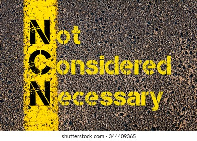 Concept image of Business Acronym NCN as Not Considered Necessary written over road marking yellow paint line.