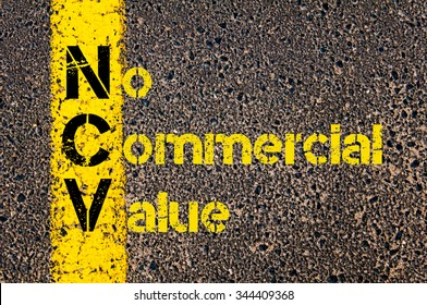 Concept image of Business Acronym NCV as No Commercial Value written over road marking yellow paint line.