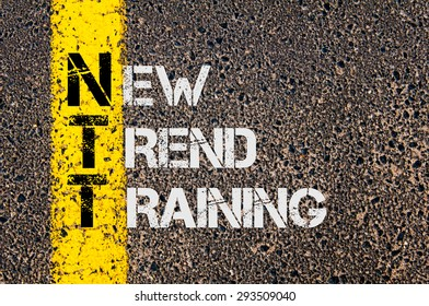 Concept image of Business Acronym NTT as New Trend Training written over road marking yellow painted line.