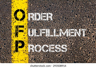 Concept image of Business Acronym OFP as Order Fulfillment Process written over road marking yellow painted line.