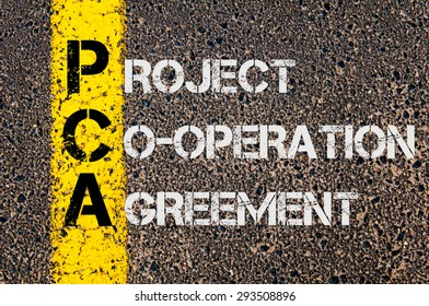 Concept image of Business Acronym PCA as Project Co-Operation Agreement written over road marking yellow painted line.