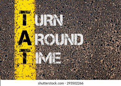 Concept image of Business Acronym TAT as Turn Around Time written over road marking yellow painted line. - Shutterstock ID 293502266