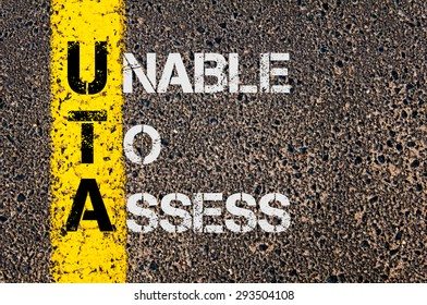 Concept image of Business Acronym UTA as Unable To Assess written over road marking yellow painted line.