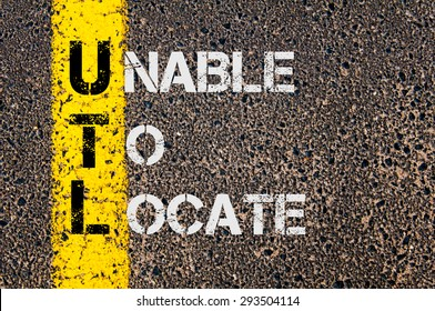 Concept image of Business Acronym UTL as Unable To Locate written over road marking yellow painted line.