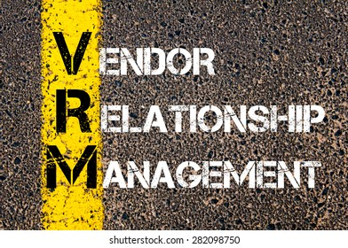 Concept image of Business Acronym VRM as VENDOR RELATIONSHIP MANAGEMENT written over road marking yellow paint line.