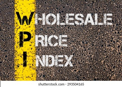 Concept image of Business Acronym WPI as Wholesale Price Index  written over road marking yellow painted line.