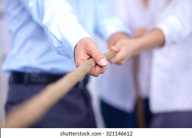 Concept image of business team using a rope as an element  the teamwork on foreground