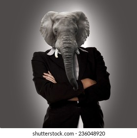 Concept image of a businesswoman with elephant head as a no nonsense boss.