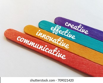 Concept image of colorful ice cream sticks and word- Creative/Effective/Innovative/Communicative on the white background/selective focus.
