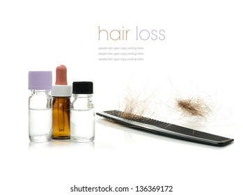 Concept image depicting alternative treatments for hair loss with medication bottles and comb against a white background. Copy space.