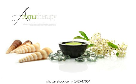 Concept image depicting aromatherapy treatments with fresh flowers and aromatic candle against a clean white surface. Copy space.