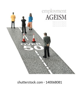 Concept image depicting employment ageism and discrimination for people over fifty. Selective focus on the road text. Copy space.