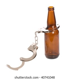 Concept image of drinking illegally featuring a beer bottle and a pair of handcuffs, isolated against a white background