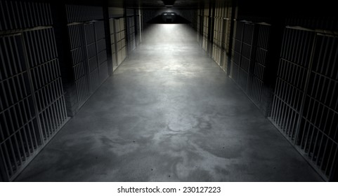 A concept image of an eerie corridor in a prison at night showing jail cells dimly illuminated by various ominous lights