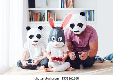 concept image of family in polygonal animal masks playing games on a play station console
