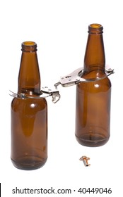 Concept image of getting arrested while being drunk, shown with two beer bottles with handcuffs on