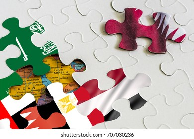 concept image of gulf countries unsolved crisis. Jigsaw puzzle piece of qatar flag being separated from other pieces featuring flags of saudi arabia UAE bahrain egypt yemen. Partly seen map.