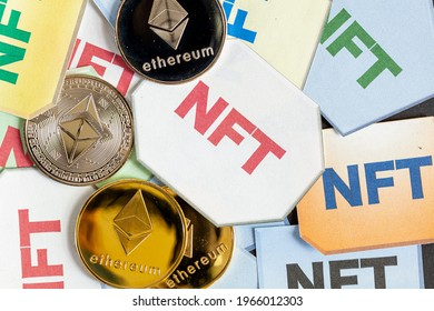A concept image for investing in Non Fungible Tokens (NFTs) through Ethereum blockchain. These are rare digital items that are traded online. Image shows NFTs with ETH coins on dark background