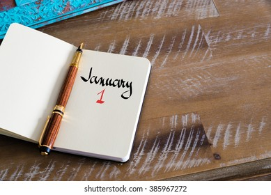 Concept image of January 1 Calendar Day with empty space for text as handwritten note with fountain pen on a notebook