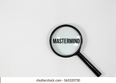 A concept image of a magnifying glass isolated white background with a word MASTERMIND zoom inside the glass