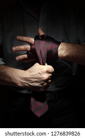 Concept image of man getting ready for office fight with a tie on his fist
