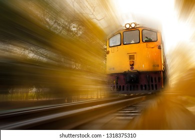 Concept image of movement train on the railway, image made motion blur and warm tone.
