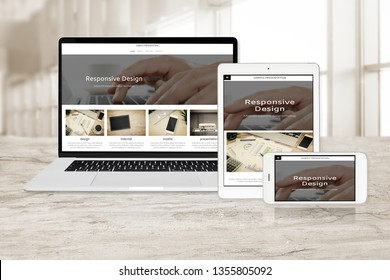 Concept image of multi device technology for responsive web design - laptop , digital tablet and smartphone in various orientation at the office (sample web page).