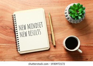 concept image with new mindset new results text. top view of office table