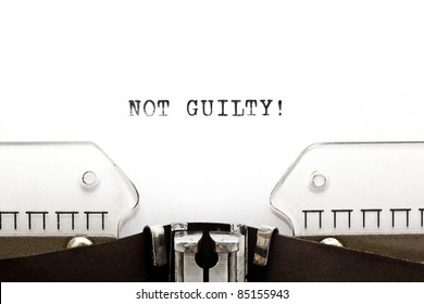 Concept image with NOT GUILTY! written on an old typewriter