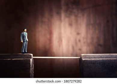 Concept image of person crossing dangerous cliff