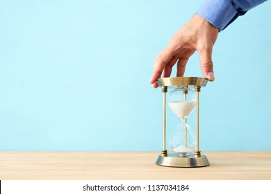 concept image of person holding hourglass. deadline and schedule concept
