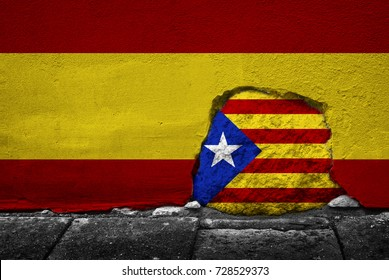 Concept image. Stone in the cement Spain flag wall with Catalonia flag on it. National symbol. Independence and patriotism theme.
