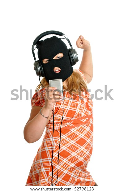 Concept image of a young girl dancing to pirated or illegal music downloads on her mp3 player, isolated against a white background.