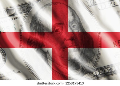 The concept of the impact of US currency on the country. One hundred dollar bill against the background of the developing flag of England.