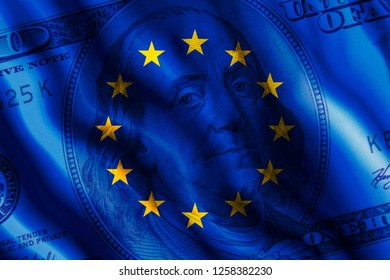 The concept of the impact of US currency on the country. One hundred dollar bill against the background of the developing flag of European Union. (E.U.)