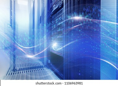 The concept of information technology, big data, security and hacking. The waves of binary code cover the data center disk storage. room with rows of server hardware in the data center