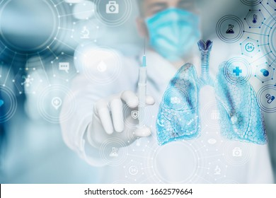 The concept of inpatient treatment of the lungs. Doctor shows a syringe on a blurred background.