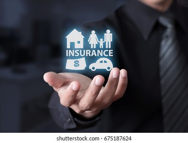 Concept of insurance with house, car, family and money